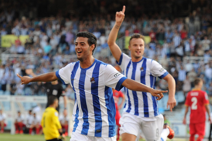 SAN SEBASTIAN, SPAIN - AUGUST 17:  Carlos Vela of Real Sociedad celebrates after scoring his team's opening goal during the La Liga match between Real Sociedad and Getafe at Estadio Anoeta on August 17, 2013 in San Sebastian, Spain.  (Photo by Denis Doyle/Getty Images)