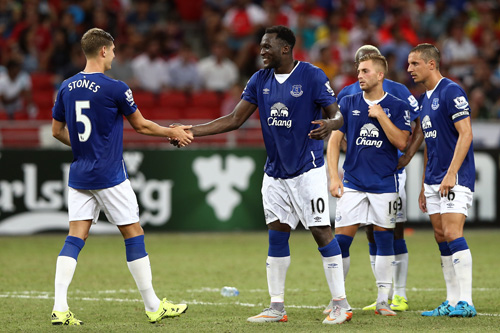 SINGAPORE - JULY 15: John Stones of Everton is congratulated by Romelu Lukaku after he scored the penalty against Stoke City during the Barclays Asia Trophy match between Everton and Stoke City at National Stadium on July 15, 2015 in Singapore. (Photo by Stanley Chou/Getty Images)