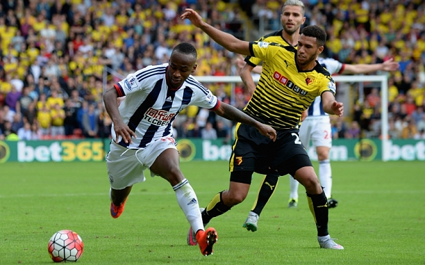 WATFORD, ENGLAND - AUGUST 15: Saido Berahino of West Bromwich Albion and Etienne Capoue of Watford compete for the ball during the Barclays Premier League match between Watford and West Bromwich Albion at Vicarage Road on August 15, 2015 in Watford, United Kingdom.  (Photo by Tony Marshall/Getty Images)